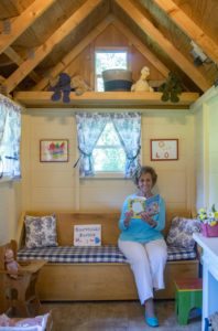 Betty Farr in her playhouse for children