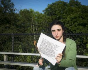 Celina Odeh with Jenny Holzer's Inflammatory Essays